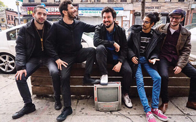 Acclaimed jazz bassist Omer Avital, second from left, with his Qantar quintet, has a new recording. Catch it online. Omeravital.com