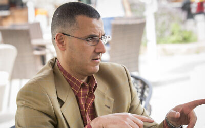 Omar Barghouti speaks to artists at the 2014 Palestine Festival of Literature about the Boycott, Divestment and Sanctions (BDS) campaign in Acre, Israel, June 3, 2014. He is one of the co-founders of the movement. (Rob Stothard/Getty Images/via JTA)