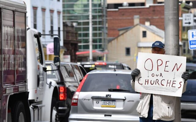A man takes part in a protest to reopen Pennsylvania businesses  and houses of worship in Harrisburg, April 20, 2020. (Nicholas Kamm/AFP via Getty Images)