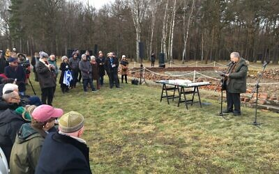 Menachem Z. Rosensaft, right, leads a delegation from the World Jewish Congress in a memorial service near the remains of the crematoria at Auschwitz-Birkenau, Jan. 28, 2020. (Jewish Week)