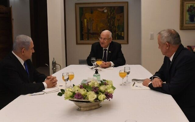 Israeli President Reuven Rivlin, center, meets with Prime Minister Benjamin Netanyahu, left, head of the Likud party, and Benny Gantz, chair of Blue and White, to discuss forming an emergency unity government, March 15, 2020. (Koby Gideon/GPO/via JTA)