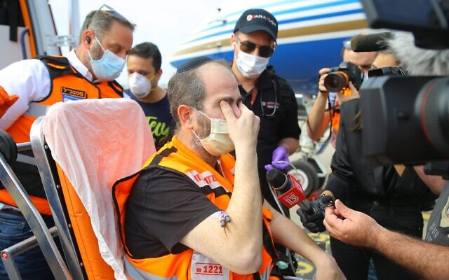 United Hatzalah's President and Founder Eli Beer lands in Israel on April 21, 2020, after recovering from Covid-19 in a Miami hospital. Beer was flown back to Israel on the private jet of Miriam Adelson and was cared for by a health team including a doctor and paramedic from United Hatzalah. (Shira Hershkop-United Hatzalah)