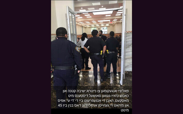 Cell phone footage shows police arriving at the Nitra Yeshiva in the Bedford-Stuyvesant neighborhood of Brooklyn, where some 60 students were said to be gathering in violation of social distancing regulations, May 18, 2020. (Via JTA)