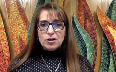 Rabbi Lisa Malik of Temple Beth Ahm of Aberdeen, N.J., recites a prayer on Zoom from her empty synagogue's chapel on Israel's Memorial Day. The Conservative movement has given its rabbis a green light to stream services on the High Holidays and Shabbat.
