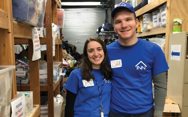 The author and his girlfriend at a L.I. soup kitchen. Courtesy of Isaac Adlerstein