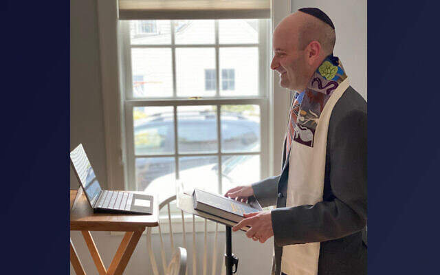Rabbi Danny Burkeman of the Reform synagogue Temple Shir Tikvah in Wayland, Mass., leads services from his home. Now Conservative synagogues will also be allowed to livestream on Shabbat services under certain parameters. (Courtesy of Burkeman)