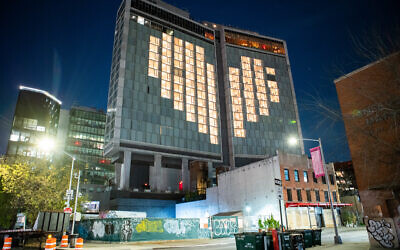 The Standard Hotel along Manhattan's High Line offered a message of support for the city's healthcare workers on April 20, 2020. Today is Giving Tuesday. (Anthony Quintano/Flickr Commons)