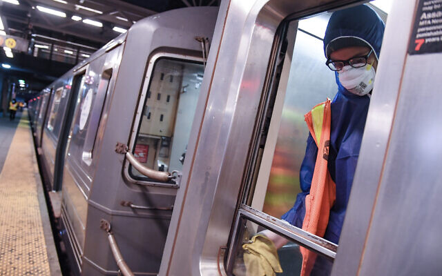 A transit worker disinfects a subway car at the Coney Island Stillwell Ave. Terminal on May 7, 2020. For the first time in its 115-year history, New York City deliberately shut down its entire subway system Wednesday morning, for cleaning and homeless outreach. (Marc A. Hermann / MTA New York City Transit)