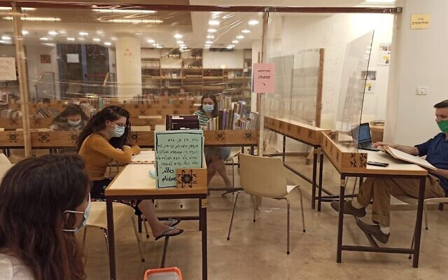 Nishmat, an Orthodox women's seminary in Jerusalem, is among the Israel-based gap-year programs making adjustments to ensure their programs can start in the fall, JTA reports. Above, students at Nishmat wear masks and are separated by Plexiglas barriers to protect against the coronavirus. (Courtesy of Nishmat)