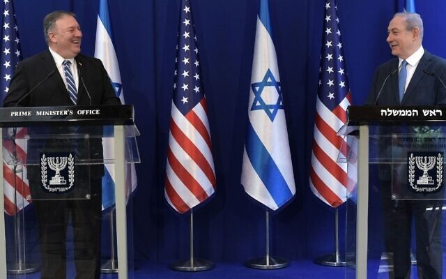 """U.S. Secretary of State Mike Pompeo, left, and Israeli Prime Minister Benjamin Netanyahu  meet in Jerusalem, May 13, 2020. They discussed the coronavirus pandemic, among other topics, with Pompeo telling Netanyahu: """"You're a great partner, you share information -- unlike some other countries that try and obfuscate and hide that information,"""" an apparent reference to China. (Kobi Gideon/GPO)"""