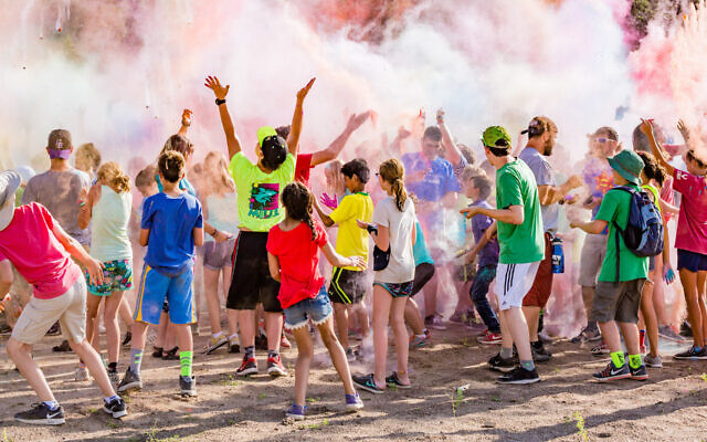 Like many camp activities, the 2017 color war at JCC Ranch Camp in Colorado involved crowds of kids. This year, with its summer session canceled, the camp is becoming a family camp with socially distanced activities. (Noah Gallagher/via JTA)
