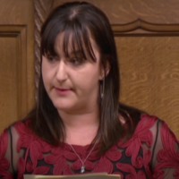 "In a scene from the PBS documentary ""Viral,"" Ruth Smeeth, a member of Parliament from the U.K.'s Labour Party, reads anti-Semitic messages that have been directed at her. (PBS.org)"