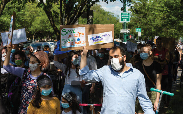 On Sunday, June 7, more than 100 members of the Crown Heights Chabad community march for racial justice along Eastern Parkway in Brooklyn. Mo Gelber