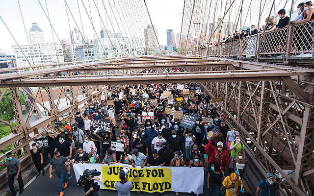 Protestors marching across the Brooklyn Bridge this week in support of George Floyd. Rabbis say the protests could re-energize black-Jewish relations.
