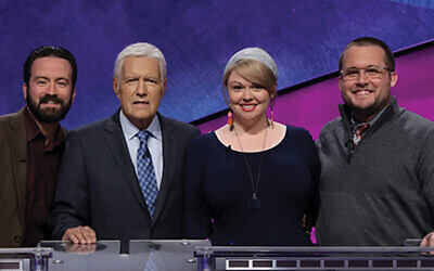 """Beit Rabban teacher Meggie Kwait won $50,000 on the recent """"Jeopardy!"""" educators tournament. She is seen with host Alex Trebek, second from left, and the other two finalists.  Courtesy of Jeopardy Productions Inc."""