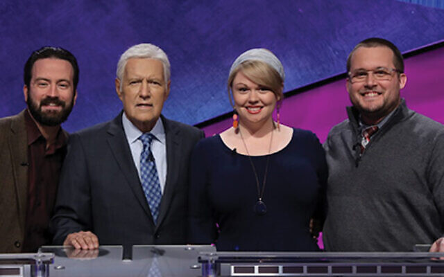 "Beit Rabban teacher Meggie Kwait won $50,000 on the recent ""Jeopardy!"" educators tournament. She is seen with host Alex Trebek, second from left, and the other two finalists.  Courtesy of Jeopardy Productions Inc."