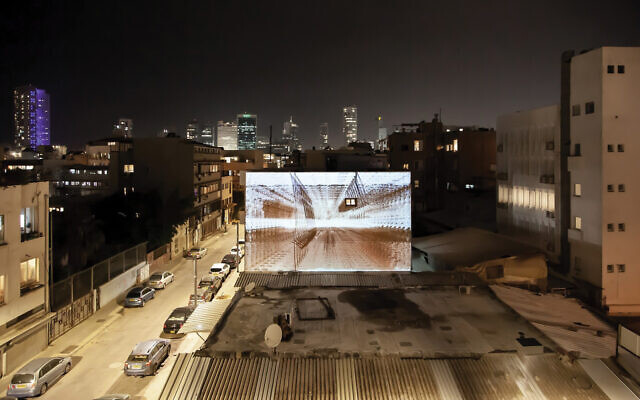 Dor Zelicha Levi's video installation on a wall he sees from the window of his studio. Courtesy Dor Zelicha Levi