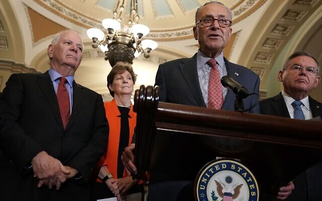 Senate Minority Leader Chuck Schumer, at mic, speaks at a news briefing at the Capitol, July 17, 2018. Left to right in the background are Sens. Ben Cardin, Jeanne Shaheen and Robert Menendez. (Alex Wong/Getty Images)