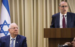 Gideon Taylor, right, then-chair of operations of the World Jewish Restitution Organization, speaks at a 2017 conference on stolen Jewish property at the official residence of Israeli President Reuven Rivlin. Hadash Parush/Flash90