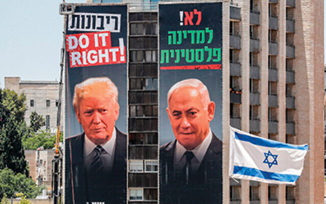 Giant posters on buildings in Jerusalem feature photos of Israeli Prime Minister Benjamin Netanyahu and President Donald Trump, beneath slogans supporting West Bank annexation and opposing a Palestinian state.  Ahmad Gharbali/AFP via Getty Images