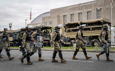 "Troops on their way to the George Floyd protests in Washington, D.C. In a Times op-ed, Republican Sen. Tom Cotton called for federal troops to meet the protestors with ""an overwhelming show of force."" Getty Images"