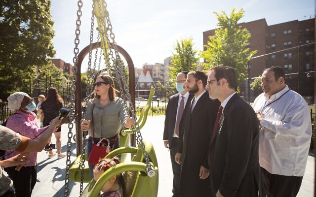 New York City Councilman Kalman Yeger, second from right, at a Brooklyn playground, June 16, 2020. Yeger has been fighting to have sleepaway camps opened this summer. (Benjamin Kanter)
