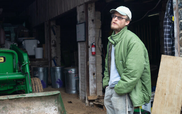 Ian Yosef Hertzmark at his farm in Randallstown, Md., in February. His sales of flour have more than doubled during the pandemic. (Mike Tintner/via JTA)