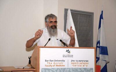 Rabbi Yuval Cherlow delivering a lecture at Bar Ilan University's Azrieli School of Medicine. Photos courtesy of Tzohar