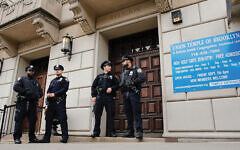 "NYPD officers in front of Union Temple in Brooklyn. Says a Queens rabbi, ""We feel we're under siege."" Getty Images"