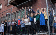 Children look on as a Black Lives Matter protest passes through Williamsburg, June 12, 2020. (Avi Kaye)