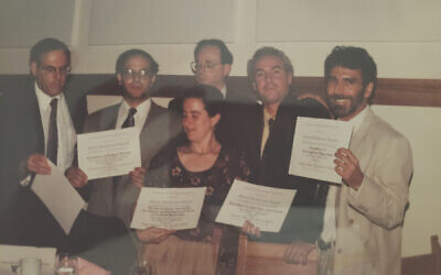 Jewish Week staff writers and editors Stewart Ain, left, Adam Dickter, Toby Axelrod, Gary Rosenblatt, Robert Goldblum and Larry Cohler-Esses posing with writing awards from the American Jewish Press Association in the early 1990s.