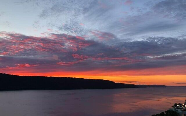 Sunset over the New Jersey Palisades, seen across the Hudson River from Yonkers, N.Y. (Stephen J. Carroll)
