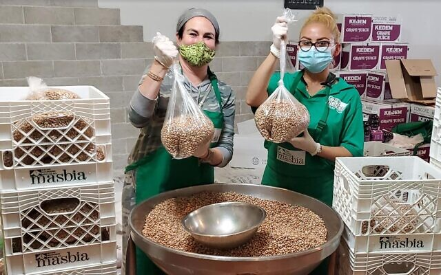 "Naomi Nachman, ""The Aussie Gourmet,"" left, pitches in as the Masbia Soup Kitchen Network mobilizes a $2 million crowdfunding effort. (Masbia)"