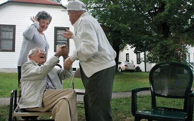 """Holocaust survivors seen enjoying one of their last summers at a Catskill Mountains bungalow colony in the 2008 documentary (Four Seasons Lodge."""" (Rainlake Productions)"""