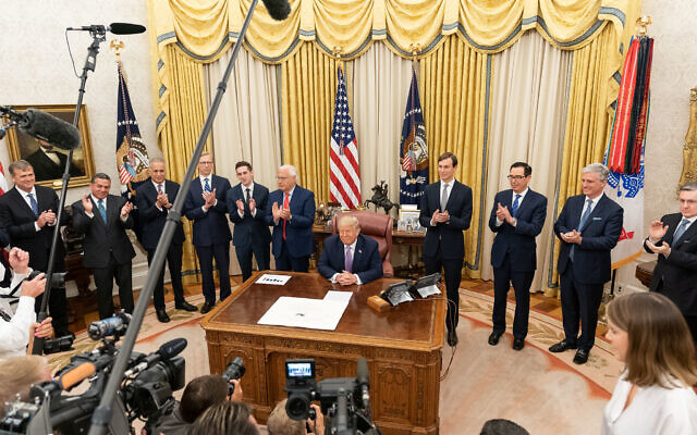 President Donald J. Trump, joined by White House senior staff members, announces the agreement between Israel and the United Arab Emirates to seek diplomatic ties, Aug. 13, 2020, in the Oval Office of the White House. (Official White House Photo by Joyce N. Boghosian)