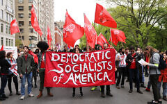 Members of the Democratic Socialists of America gather outside of a Trump-owned building on May Day, 2019 in Manhattan. (Spencer Platt/Getty Images)