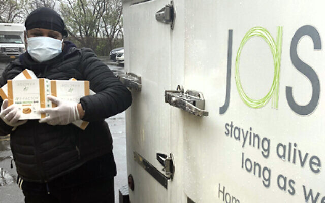 UJA-Federation of New York funded and secured hard-to-come-by personal protective equipment (PPE), including masks and gloves, for agencies that included JASA, which delivers meals to homebound elderly in Brooklyn and Queens during the pandemic. (UJA-Federation)