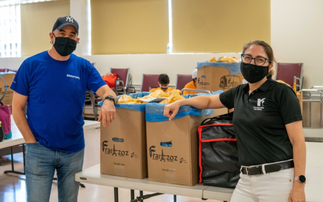Doron Krakow, president and CEO of JCC Association of North America, and Deann Forman, CEO at Riverdale Y, help prepare, package and deliver meals at the Riverdale Y as part of its meal delivery offerings, Aug. 24, 2020. (Riverdale Y)