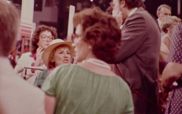 Bella Abzug (in hat, of course), Liz Holtzman (with back to camera) and Geraldine Ferraro, partly obscured on right, at the 1980 Democratic National Convention at Madison Square Garden. (Steve North)