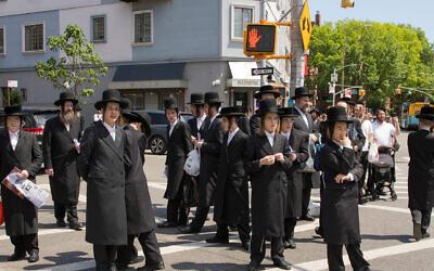 Williamsburg residents look on as protesters pass through the Brooklyn neighborhood June 12, 2020. (Avi Kaye)