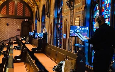 Members of the chorus at Central Synagogue in Manhattan prepare for a livestream of services. The Reform synagogue's sanctuary, which normally seats 1,100 worshippers on the High Holidays, will be empty this year. (Facebook)