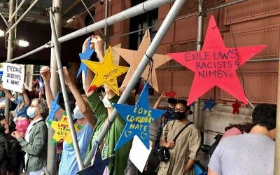 "Supporters of homeless services on the Upper West Side hung ""Stars of Hope"" signs outside The Lucerne hotel on the Upper West Side of Manhattan, and then marched to the mayor's residence protested the planned transfer of the shelter residents living in the hotel during the Covid-19 pandemic, Sept. 13, 2020. (UWS Open Hearts)"