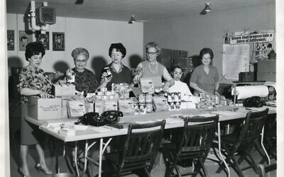 Members of the Jewish Welfare Board, in an undated photograph, pack canned goods for servicemen. (Flickr Commons/Jewish Museum of Maryland)