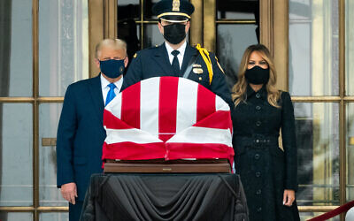 """President Trump and First Lady Melania Trump pay their respects to Associate Justice Ruth Bader Ginsburg Thursday, Sept. 24, 2020, as she lies in repose at the U.S. Supreme Court in Washington, D.C. """"Vote him out,"""" crowds began chanting when Trump appeared before the flag-draped coffin. Ginsburg, the second woman to serve on the Supreme Court, will be the first woman to lie in state in the United States Capitol on Friday. (Official White House Photo by Andrea Hanks)"""
