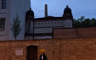 Standing at the door of the Halle synagogue,  for the first time after the attack, one year later. This is the door and street Sharfman walked out for a walk a few minutes before the assailant arrived and a few feet from where Jana Lange was killed. Photo Credit: Amie Liebowitz