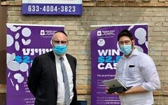 MAKING IT COUNT: Ari Weisenfeld, Agudath Israel's development coordinator, and Rabbi Yeruchim Silber, Agudath Israel's director of New York government relations, at a pop-up census drive in Borough Park on Sept. 17. Weisenfeld organized the drive in order to encourage more community members to fill out the census before the deadline of Sept. 30, 2020. (Agudath Israel of America)