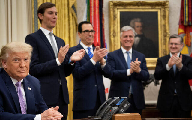 Officials clap at the White House after President Donald Trump announced an agreement between the United Arab Emirates and Israel to normalize diplomatic ties, August 13, 2020.. (Brendan Smialowski/AFP via Getty Images)