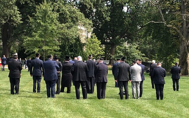 Following the signing of peace accords among Israel, United Arab Emirates and Bahrain, observant Jews held an afternoon Mincha service on the White House lawn, Sept. 15, 2020. (Twitter)