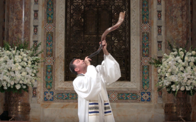Rabbi Joshua M. Davidson blows a shofar during services broadcast from Temple Emanu-El in New York City. (Courtesy)