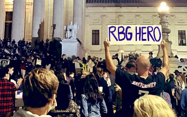 Mourners gathered on the steps of the Supreme Court Saturday to remember Ruth Bader Ginsburg, the Supreme Court justice who died Friday, Sept. 18, at age 87. (Halie Sofer/Twitter)
